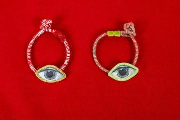 Nefeli Karyofilli Red striped bracelet (green eye)